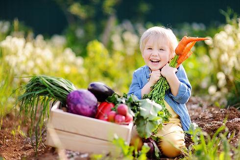 Cute little boy holding a bunch of fresh