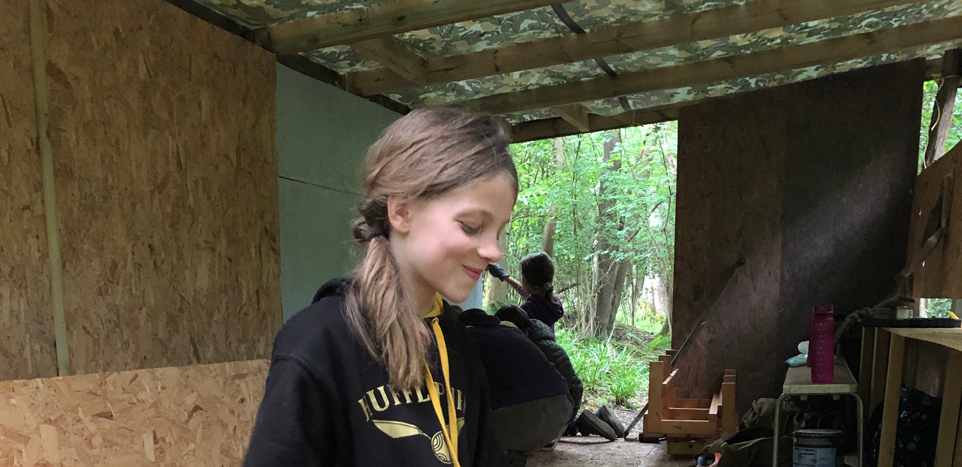 Sawing the sides of the nature hide.