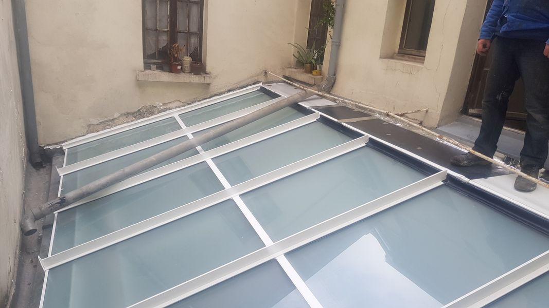 Pose de toiture vitrée - véranda