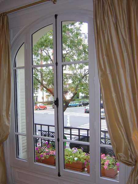 Fenêtre bois 2 vantaux cintrée