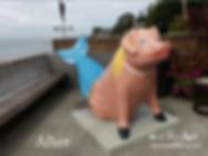 Merpig (mermaid pig) statue restoration by Tamara Hergert - Mural artist in Seattle