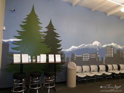 Evergreen trees and Bellevue skyline - Bel-Red Auto license - mural by Tamara Hergert
