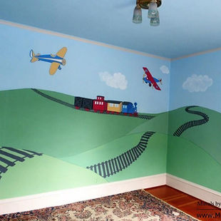 Airplanes and a train on train tracks mural by Tamara Hergert - mural artist seattle