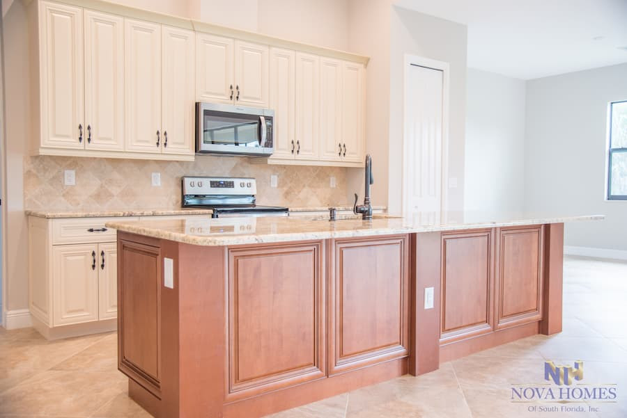 Home with Kitchen Island in South Florida by Nova Homes