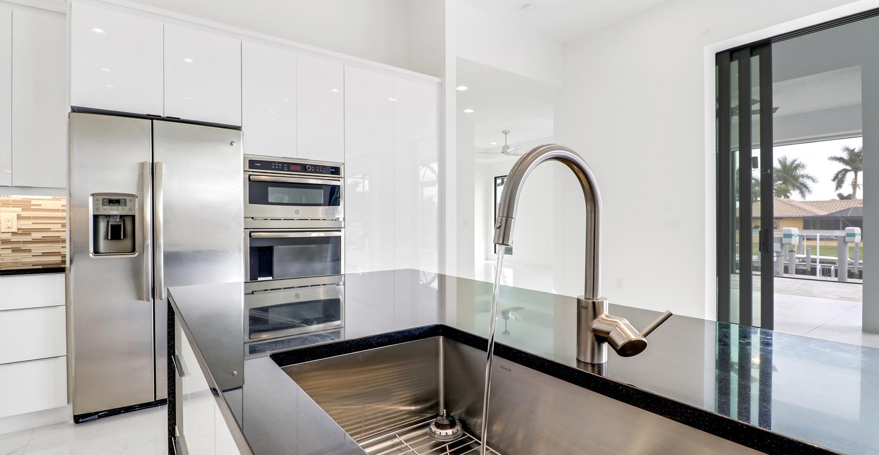 Jamaica Court home in Marco island Interior Kitchen sink and fridge