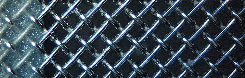 From production: microscopic view of a screen printing fabric for printing metal layers on PV cells.