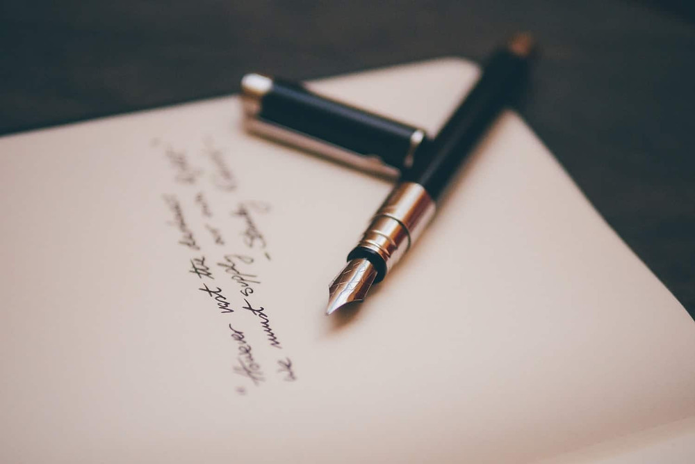 Fountain pen and paper with handwritten poem