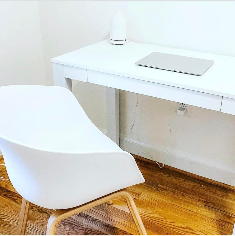 White modern writing desk and chair in Victoria Kelly's creative space