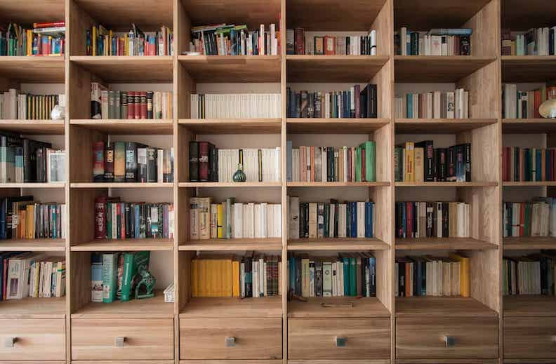 Wooden book shelves filled with books