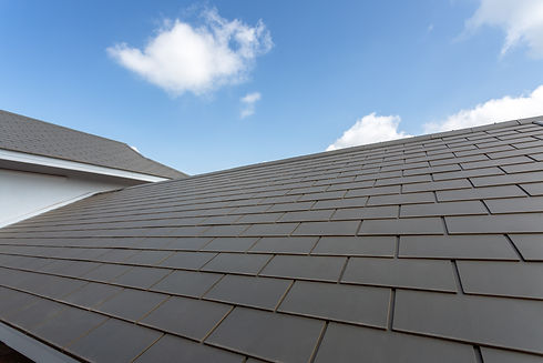 Slate roof against blue sky, Gray tile r