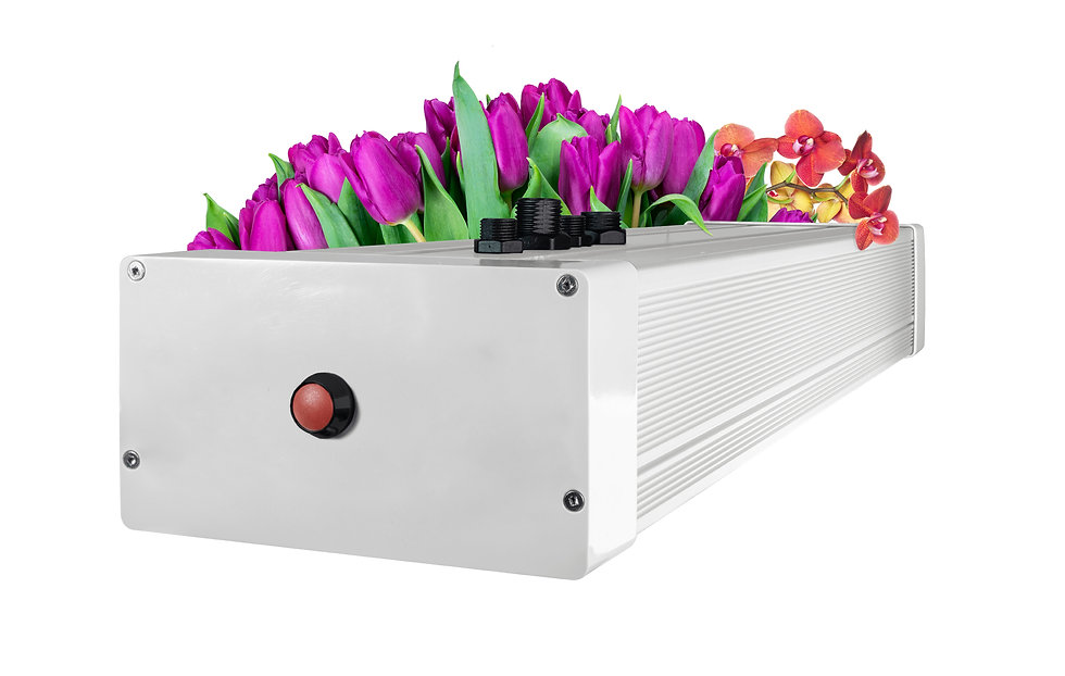 Grow3 LED grow light Fixture with flowers behind it
