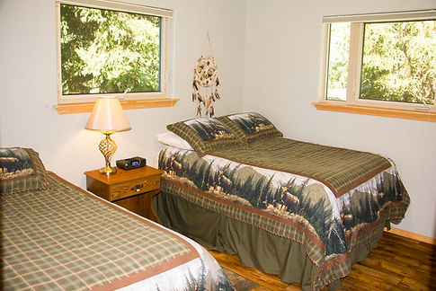 Bedroom with one full and one twin bed.