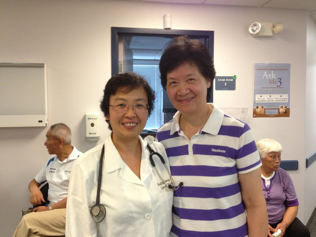 Dr. Qiufang Cheng with patient