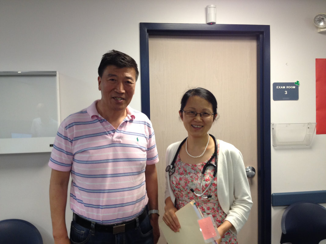 Dr. Lei Xu with patient