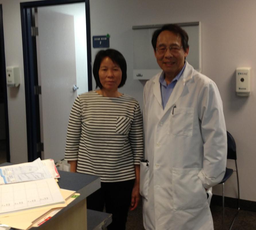 Dr. Hon Yuen Wong with patient
