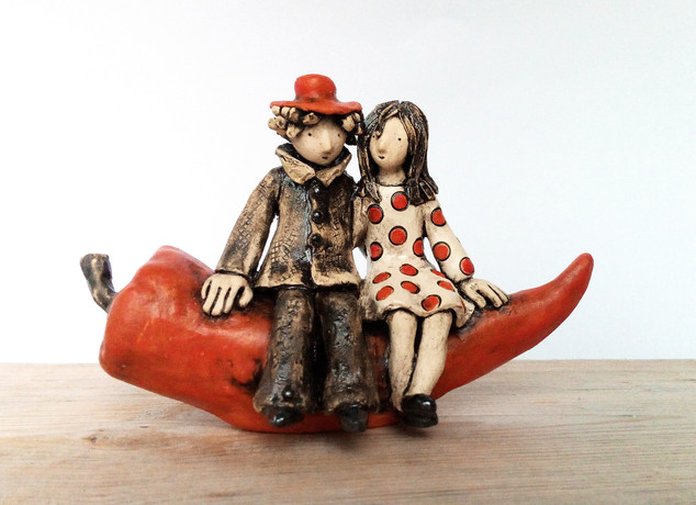 Romantic Couple Sitting on a Red Pepper-