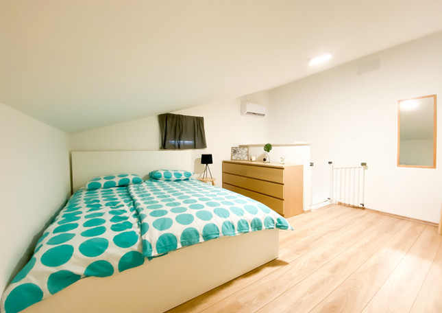 Upstairs bedroom with double bed