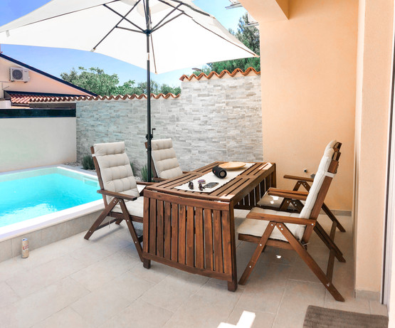 Outside dining area with a pool...