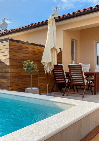 Pool area with outdoor dinning table