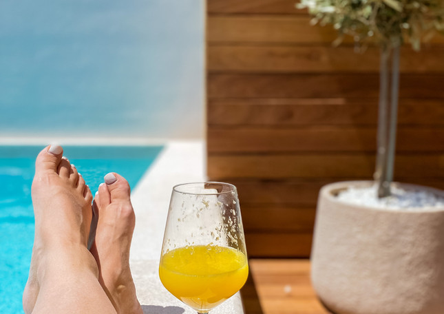 Relaxing by the pool with your favorite drink