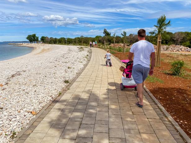 Peroj beach with a walking path...