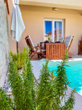 Swimming pool area with dinning table...