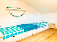 Upstairs bedroom with two single beds...