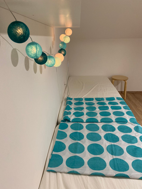 Upstairs bedroom with two single beds and one double bed...