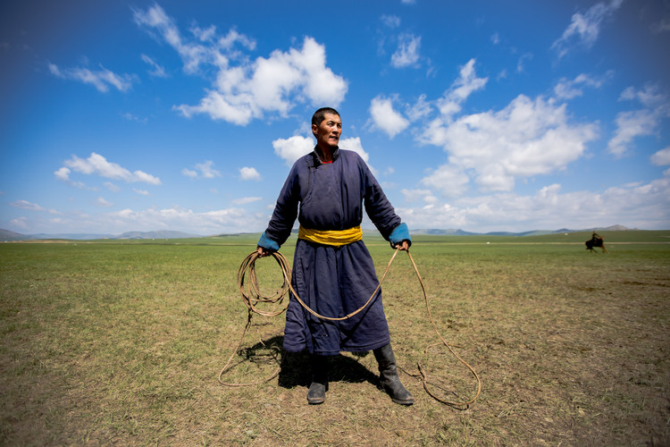 A herder wearing a traditional dress in Mongolia's hinterland (2017).