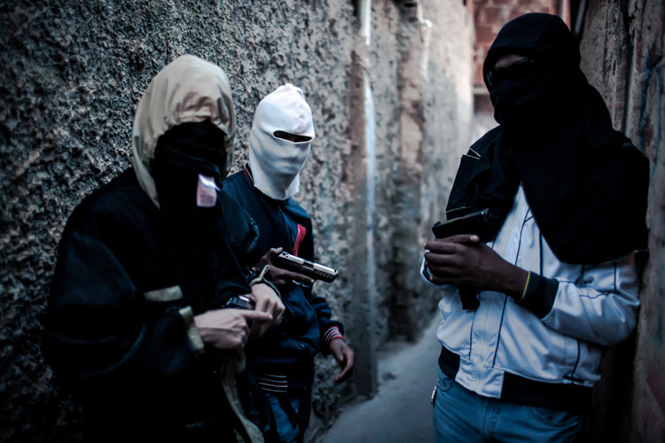 """Most favelas in Caracas, Venezuela are controlled by gangs who finance themselves and their community with so called """"express kidnappings"""" lasting only for a few hours until enough money was withdrawn from the next ATM (Caracas, Venezuela, 2016)."""