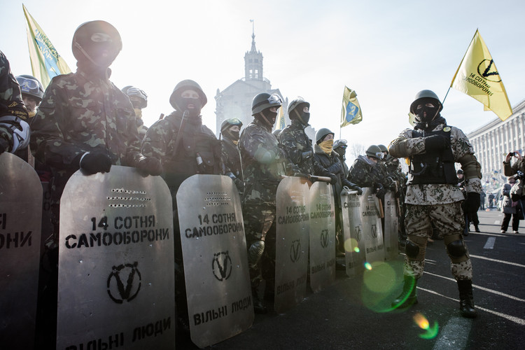 Anti-government protestors organized themselves in militias wearing makeshift armor and shields while patrolling Maidan Square in Kiev during the Euromaidan protests (Ukraine, 2014).