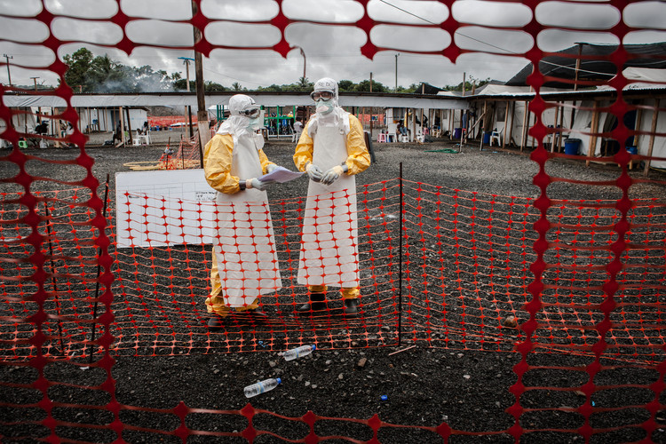 Two US doctors wearing Personal Protective Equipment (PPE)  insider a highly infectious Ebola Treatment Unit (Monrovia, Liberia, 2014).