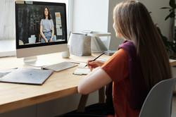 girl-watching-video-using-imac-4144225.j