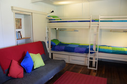 The sofa bed and bunks