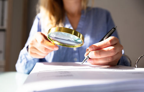 magnifying-glass-woman-paper.jpg