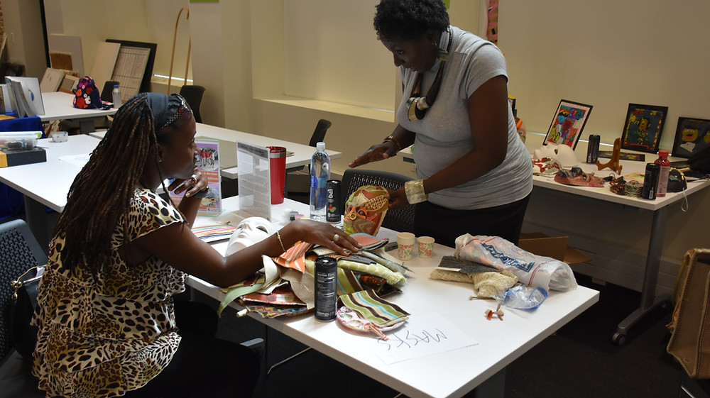 Cynthium Johnson-Woods demonstrates mask-making