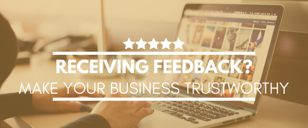 "Header regarding receiving reviews with a picture of a laptop in the background and text ""Receiving feedback? Make your business trustworthy"""