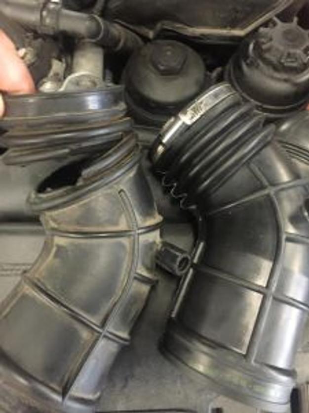 BMW check engine light repair air intake boot