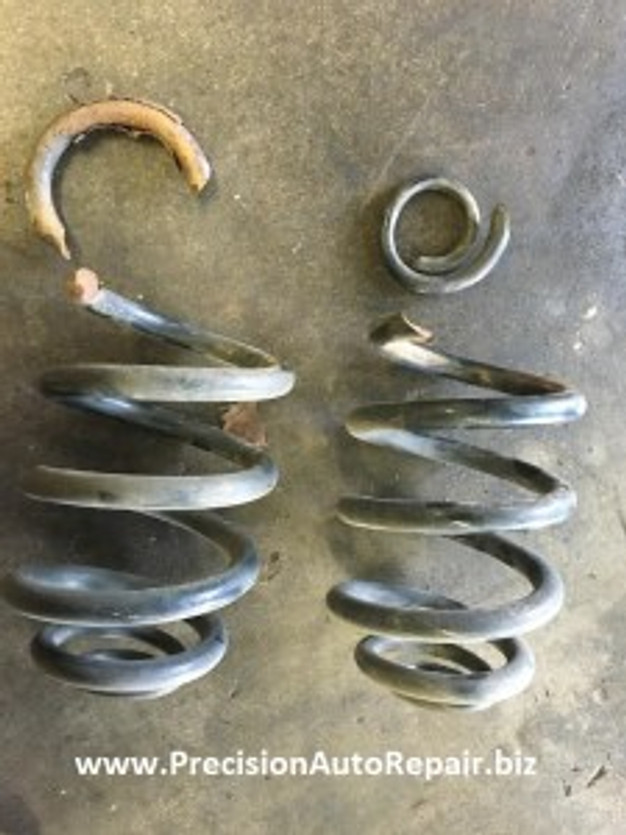 BMW repair suspension spring broken