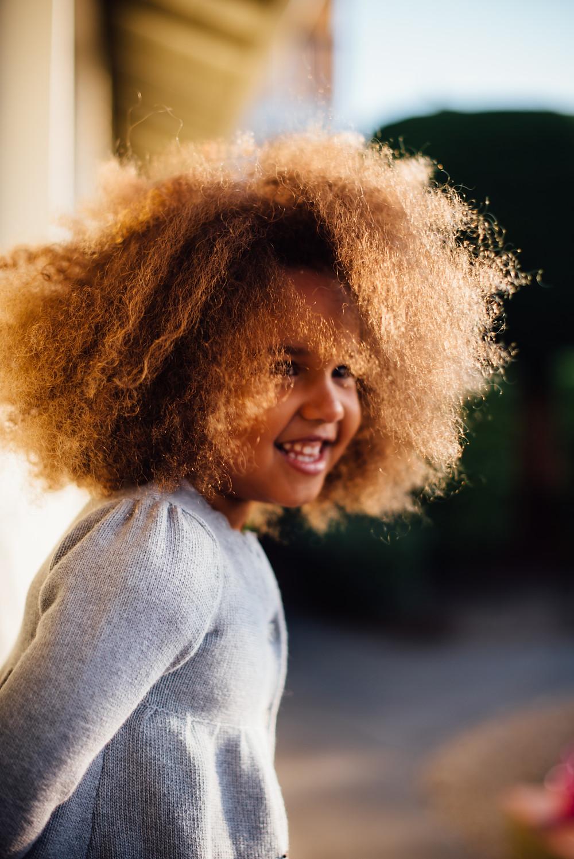 wild hair cute girl smiling for Peninsula Family Coaching