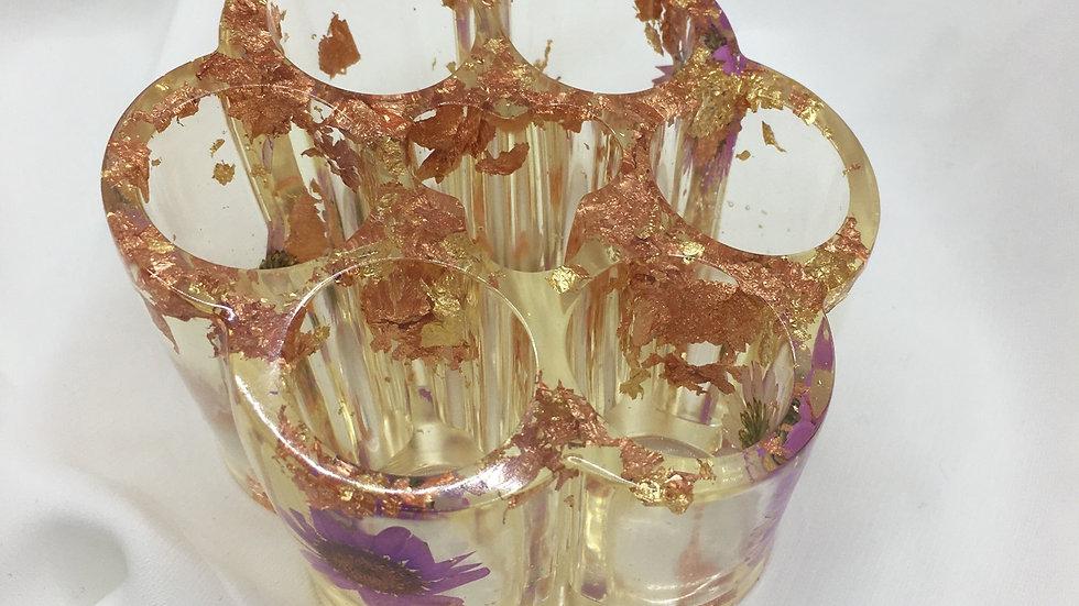 Tour de rangement rouges à lèvres cuivrée violette