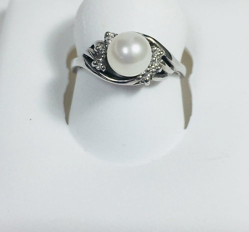 Genuine white pearl & white diamond ring.