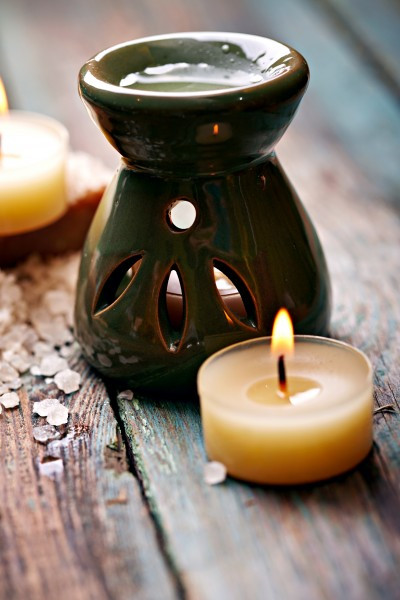 Tea light diffusers provide an old earth method of dispersing pure essential oils.  The oils are added to the top dish and heated from below to disperse the oils into the air.  Modern methods such as electric nebulizers are available, though they can be quite expensive.