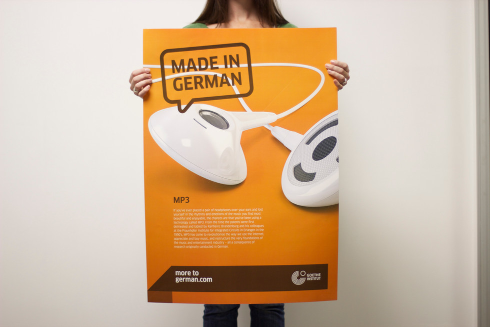 German education person holding poster