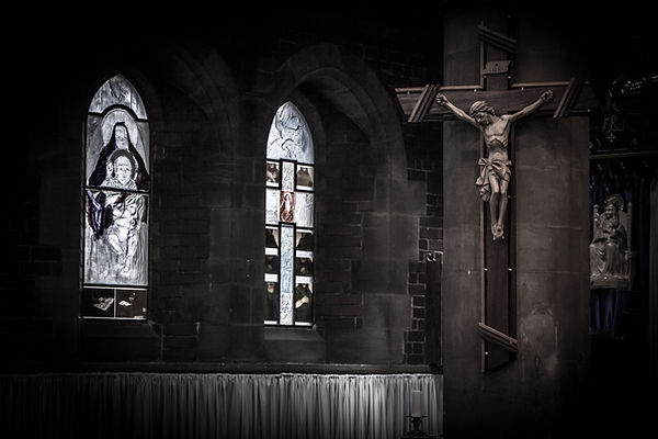 Jesus on the Cross at St Luke's Church looking over the stained glass windows from Nathalie Leige