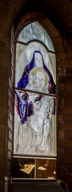 Religous stained glass commission for St Luke's church desplaying detailed painted glass and moulds