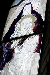 Close up of a peice for St Luke's church desplaying detailed painted glass