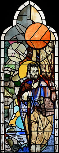 Another stained glass window designed painted and leaded depicting St James with the sun above his head on site at St James's Church in Yorkshire