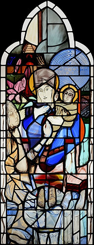 A stained glass window designed painted and leaded depicting Virgin Mary on site at St James's Church in Yorkshire
