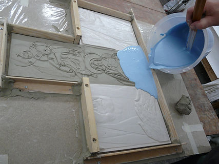 Pouring a rubber mould out to created a peice of glass for St Lukes Church